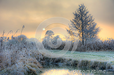 Sunset On A Foggy Winter Day At The River Paar Stock Photo.