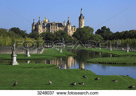 Picture of Palace garden and Schwerin Castle in the background.