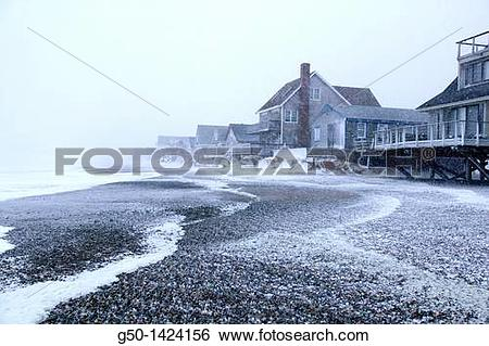 Stock Images of Ocean Front homes during Winter Storm Scituate.