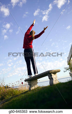 Stock Photo of Woman stretch near the beach. Scituate.