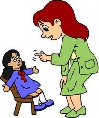 Teacher scolding a student.