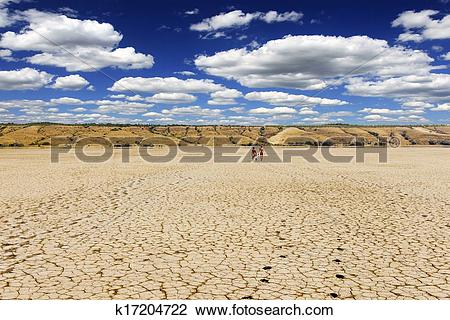 Stock Photo of Beautiful sky and scorched earth crack dried sea.