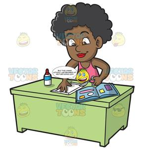 A Black Girl Cutting Paper For Her Scrapbook.