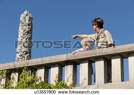 Stock Photography of Man pointing at a sculpture, Gustav Vigeland.