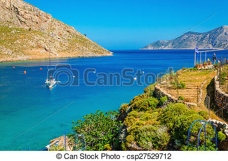 Stock Photography of Greek Island Sea bay and yacht on anchor.