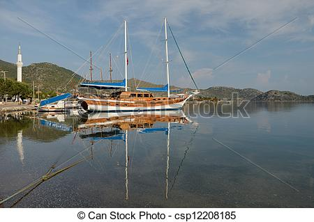 Pictures of old sailing ship in the sea bay.