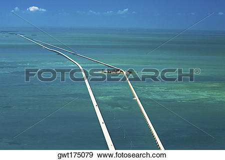 Stock Photograph of Aerial view of two bridges over the sea.
