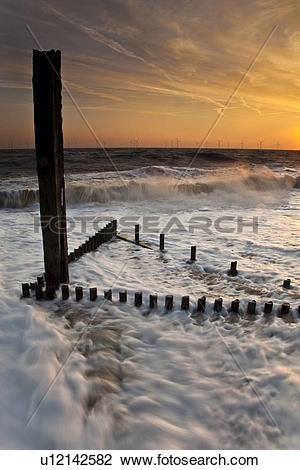 Stock Photo of England, Norfolk, Great Yarmouth, Sea defence with.