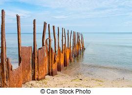 Stock Photographs of Rusty metal groynes in sea defense wall.