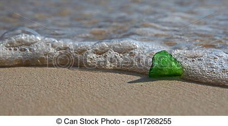 Stock Images of Green Sea Glass on the Shore.