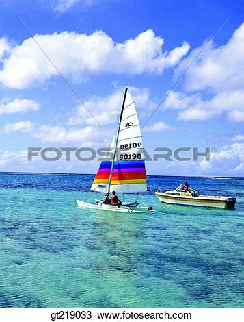 Stock Photo of wind surfing, surfing, boat, sea, sky, cloud.