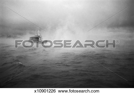 Stock Images of Passenger Boat in the Fog on the Mediterranean Sea.