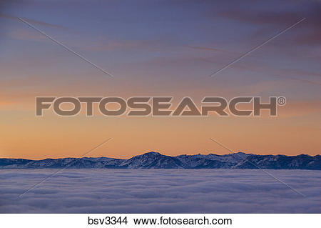 Stock Photo of Sunrise and a sea of clouds over Lake Tahoe and.