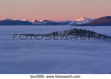 Stock Image of Sunrise and a sea of clouds over Lake Tahoe and in.