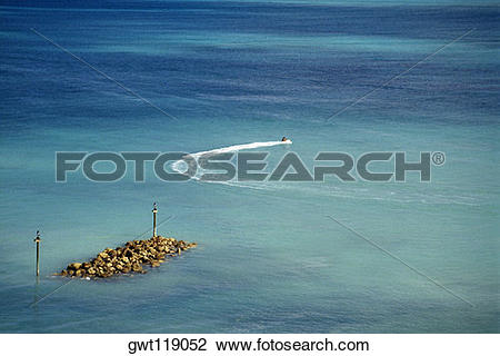 Stock Photo of High angle view of two people riding a sea scooter.