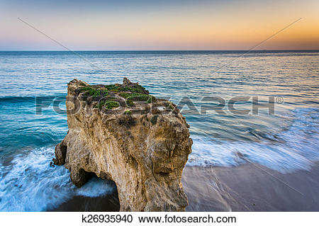 Stock Photography of Sea stack and waves in the Pacific Ocean at.