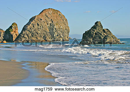 Stock Photograph of Sea stack rock formations at beach in Harris.