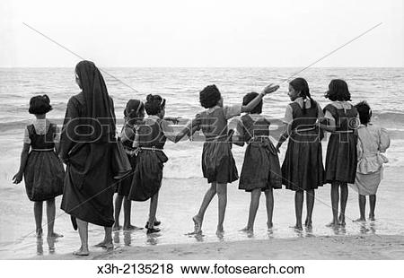 Pictures of schoolgirls and nun on the edge of the Arabian Sea.