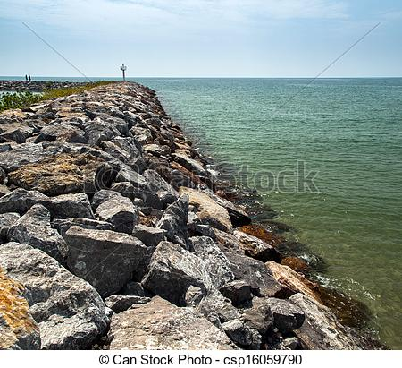 Stock Photographs of rock sea wall and ocean csp16059790.