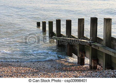 Stock Photography of Old groin water breaker sea wall csp33998401.