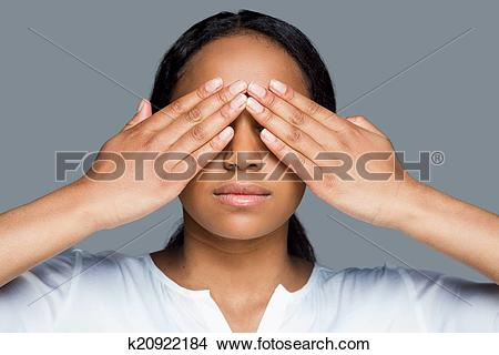 Stock Photo of I see nothing. Beautiful young African woman.