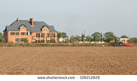 Farmer Tractor Preparing Land Seedbed Cultivator Stock Photo.