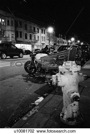 Stock Photo of Fire Hydrant On A Seedy City Street At Night.