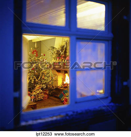 Stock Photo of CHRISTMAS PRESENTS UNDER THE TREE AND FIREPLACE.