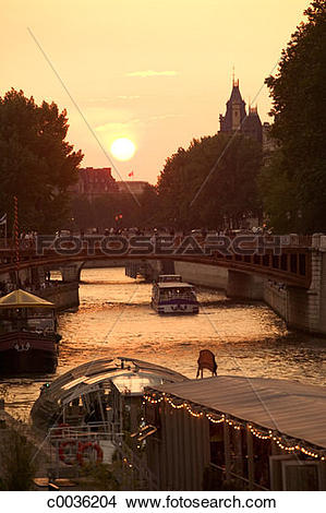Stock Photo of Boating on the Seine River in Paris at sunset.