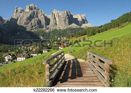 Stock Images of landscape with village Colfosco and Sella peak.