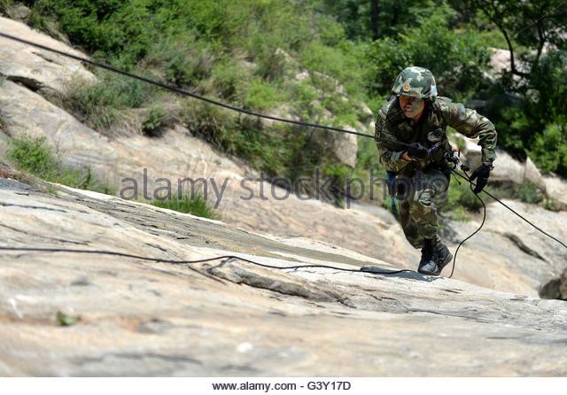 Soldier Climbing Mountain Stock Photos & Soldier Climbing Mountain.