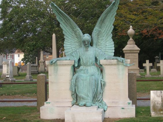 Beautiful bronze angel in Island Cemetery, Farewell St., Newport.