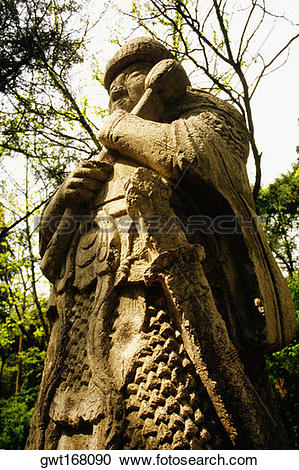 Stock Photography of Low angle view of a warrior statue, Sentinel.