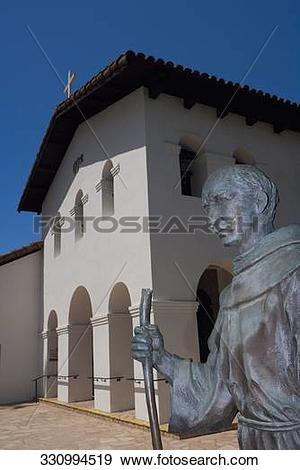 Stock Photograph of Junipero Serra statue in front of a mission.