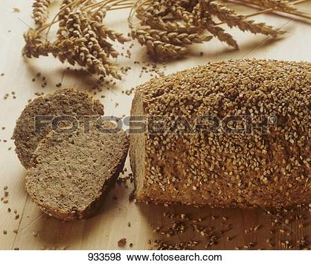 Pictures of Wholemeal wheat bread with sesame crust, ears of wheat.