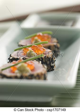 Stock Photographs of Seared Yellow Fin Tuna Rolled in Sesame seeds.
