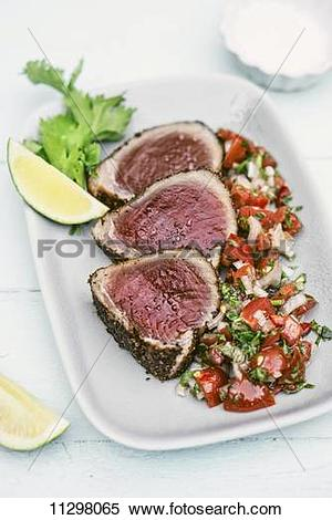 Stock Image of Tuna fish steaks with a sesame seed crust served.