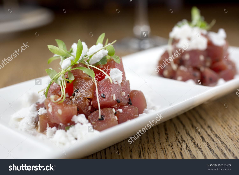 Spicy Tuna Poke With Sesame Oil Powder And Micro Cilantro Stock.