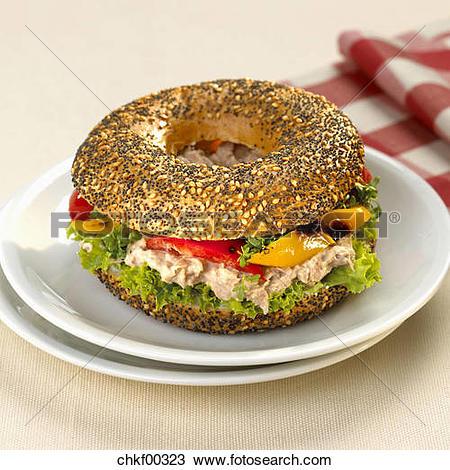 Stock Photo of Bagel with tuna salad chkf00323.