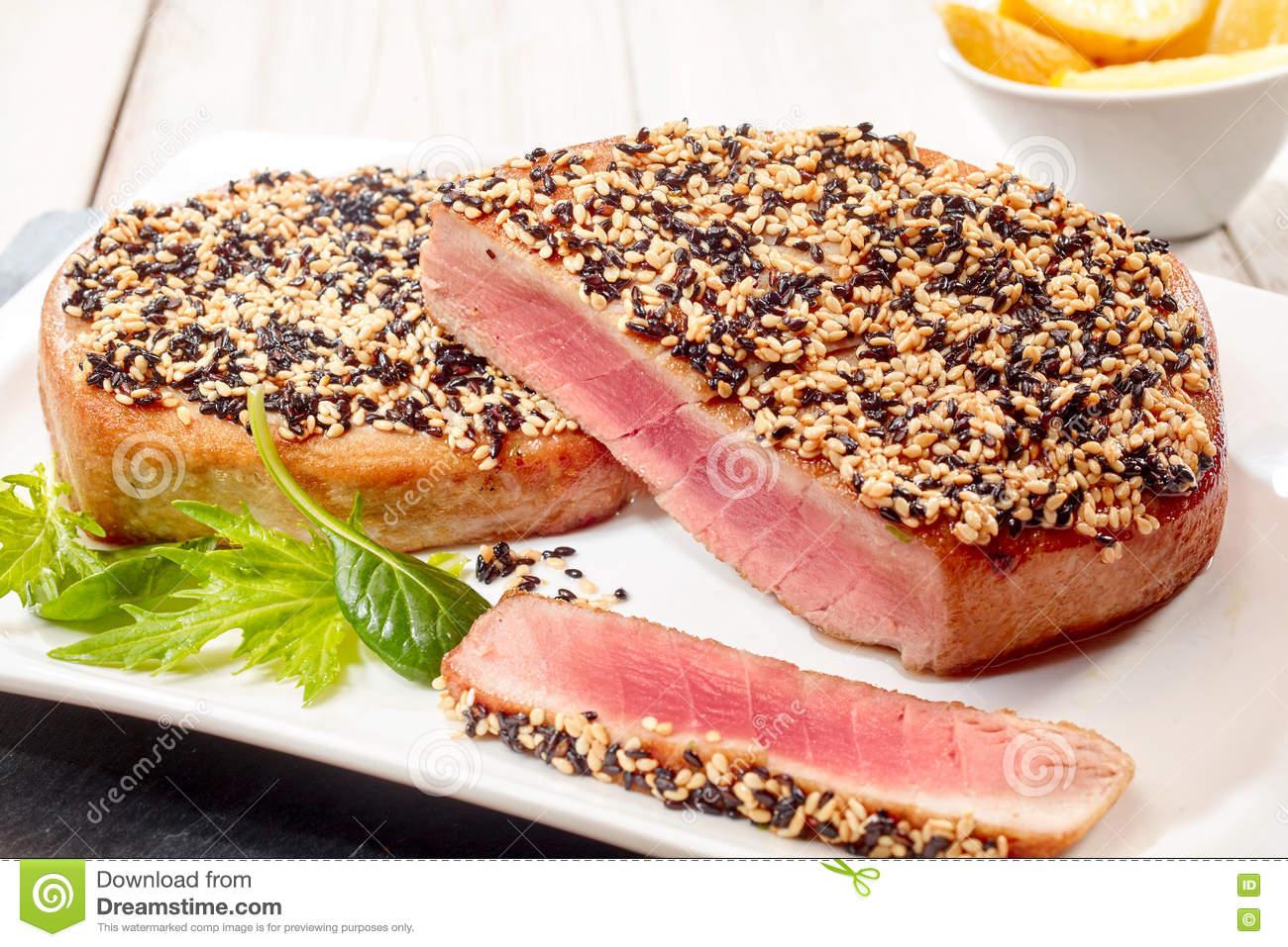 Roasted Tuna Steaks With Sesame Seed Crust Stock Photo.