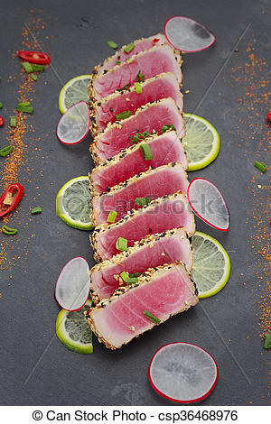 Picture of Tuna fillet with sesame decorated with limon and.