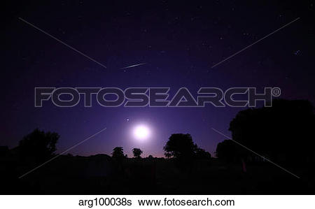 Stock Images of A bolide from the Geminids meteor shower above a.