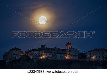 Stock Photo of Moon setting over MonteCastello di Vibio u23342683.