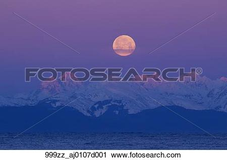 Stock Photography of Full moon setting behind the Chilkat.