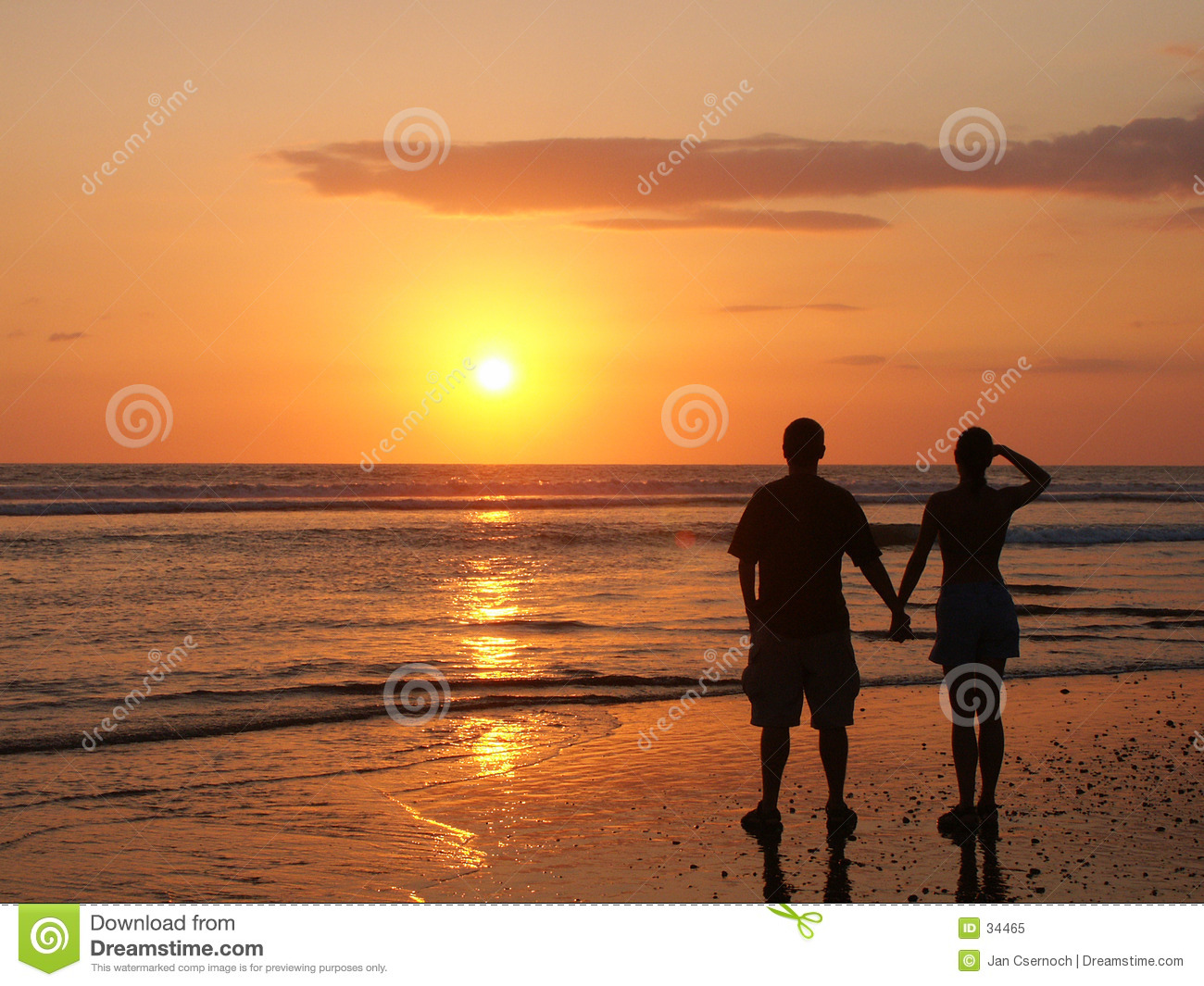 Couple Watching The Setting Sun Hand In Hand Royalty Free Stock.