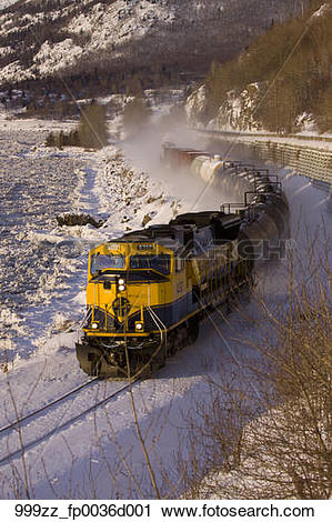 Stock Photography of An Alaska Railroad freight train travels.
