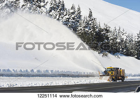 "Stock Photo of ""Snow blower clears the road along the Seward."