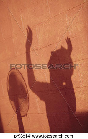 Stock Photo of Shadow of man standing in front of fan. pr93514.