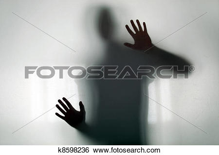 Stock Images of Shadowy figure behind glass k8598236.