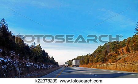 Stock Photograph of Snow lingers on the shady side k22378239.